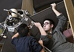 Sailors performing maintenance on LCAC aboard USS Wasp (LHD-1) 160914-N-JW440-049.jpg