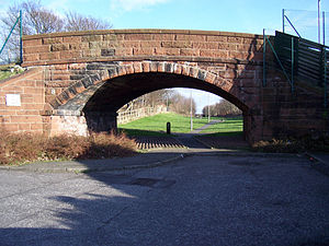 Lanarkshire and Ayrshire Railway - A half buried bridge near the site of the Saltcoats North station