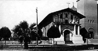 Mission San Francisco de Asís - Mission San Francisco de Asís around 1910. The wooden addition has been removed and a portion of the brick Gothic Revival church is visible at right. The large stone church was severely damaged in the 1906 earthquake.