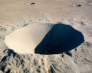 "Project Plowshare - The 1962 ""Sedan"" plowshares shot displaced 12 million tons of earth and created a crater 320 feet (100 m) deep and 1,280 feet (390 m) wide"