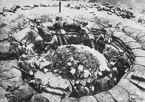 Battle of Shanghai - A Chinese machine gun nest in Shanghai. Note the German M35 used by the NRA soldiers.