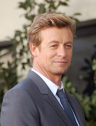 Simon Baker - Baker at a ceremony to receive a star on the Hollywood Walk of Fame in February 2013.