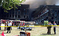 Smoke and flames rose over the Pentagon from the collapsed wall at about 10 A.M. September 11, 2001, following a suspected terrorist crash of a hijacked commercial airliner into the Helicopter Landing Pad side 010911-F-XT317-004.jpg
