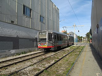 M Ocean View - An M Ocean View train in the private right-of-way at Ocean Avenue