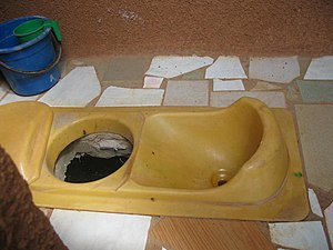Urine diversion - Squatting pan of urine-diverting dry toilet (UDDT) in Ouagadougou, Burkina Faso