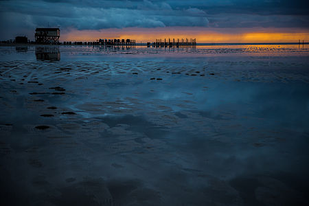 Sunset at the beach of St. Peter-Ording after a stormy day
