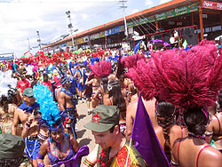 Masqueraders cross the stage at the Queen's Park Savannah during the parade