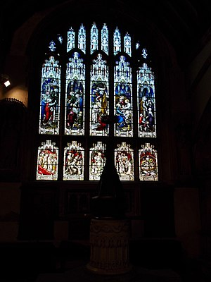 St Helen's Church, Abingdon - A stained glass window behind the baptismal font