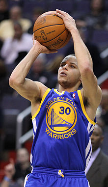 Curry taking a jump shot in 2011. Holding numerous three ...