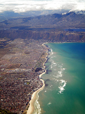 Strand, Western Cape - Aerial view of Strand on False Bay's shore, with the Hottentots-Holland, Steenbras Dam and Kogelberg beyond