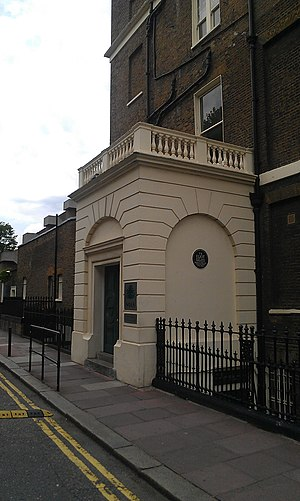 T. S. Eliot - The Faber and Faber building where Eliot worked from 1925 to 1965; the commemorative plaque is under the right-hand arch.