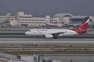 Avianca El Salvador - A TACA Airbus A320 in the airline's final livery (2008-2013) at Los Angeles.