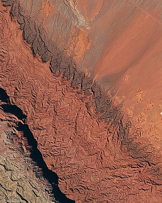 La Rioja Province, Argentina - Talampaya Natural Park hosts Triassic fossils,  200-meter (660 feet) high red sandstone cliffs and 1,500-year-old rock carvings. Landsat-8 satellite photo, 2018.