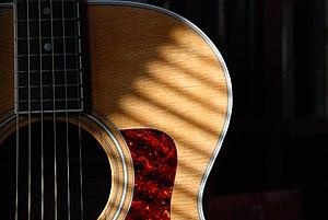 Taylor steel-string guitar.