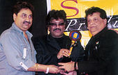 Kumar Sanu with other Thakur Doultani and Shravan
