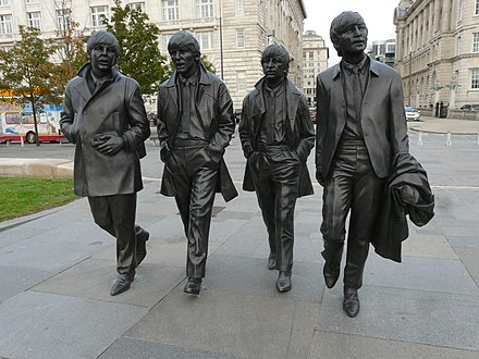 The Beatles statue in their home city Liverpool. The group are the most commercially successful and critically acclaimed band in popular music. The Beatles Statues.jpg