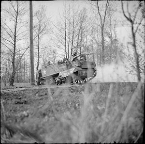 Queen's Westminsters - Universal Carrier of the 12th (Queen's Westminsters) Battalion, King's Royal Rifle Corps with Browning machine gun in action against a German MG position, the Netherlands, 2 April 1945.