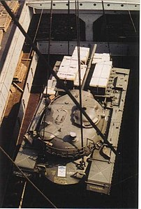 The M48 Patton tank is lowered carefully into the lower hold of TS Nabob, NY - 1959.jpg