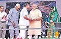 The Prime Minister, Shri Narendra Modi distributing the Cards for free medical treatment at Shri Mata Vaishno Devi Narayana Hospital, at Katra, in Jammu and Kashmir.jpg