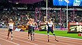The athletes - including Whitehead of ParalympicsGB - wave to the crowd (9378476980).jpg