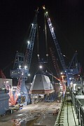 The boathouse of USS Zumwalt is moved into position. (8291330850).jpg