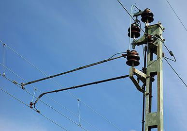 Top of pole with overhead lines.jpg