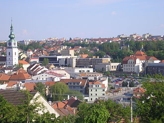 Třebíč - Komenského Square and a municipal tower, west side of  Karlovo Square is visible in the left corner, cultural complex Forum is in the middle.