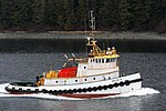 Tug pulling a load in a narrow strait (9230206483).jpg