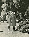 Two ladies strolling on the lawn at Ascot races, Brisbane (4903103417).jpg