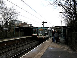Two trams at Prestwich Metrolink station.jpg