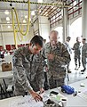 U.S. Air Force Master Sgt. Ryan Andresen, left, with the 137th Security Forces Squadron, Oklahoma Air National Guard, and 1st Lt. Jeremy Thigpen, with the 205th Engineering Installation Squadron, coordinate 130525-Z-VF620-3958.jpg