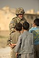 U.S. Air Force Staff Sgt. Brandon Buffa, assigned to the 577th Expeditionary Prime Base Engineer Emergency Force Squadron, talks with youth in the town of Payan Janqadam near Bagram Airfield, Afghanistan 130613-F-YL744-067.jpg