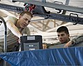 U.S. Air Force Staff Sgt. Corey Eckel teaches Airman Michael Stiffler, both with the 364th Training Squadron, how to remove and install environmental system components on an F-15 Fighting Falcon aircraft at 110923-F-NF756-007.jpg