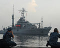 U.S. Navy Mass Communication Specialists 1st Class Josh Rodriguez, left, and Jay Pugh photograph the rescue and salvage ship USNS Safeguard (T-ARS 50) as it arrives in Jakarta, Indonesia, May 21, 2013, while 130521-N-SO584-010.jpg