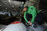 U.S. Navy Petty Officer 3rd Class Kathleen Caldwell performs maintenance on an F-A-18C Hornet in the hangar bay of the aircraft carrier USS Nimitz (CVN 68) as the ship operates in the Pacific Ocean on April 16, 2 130416-N-JC752-269.jpg