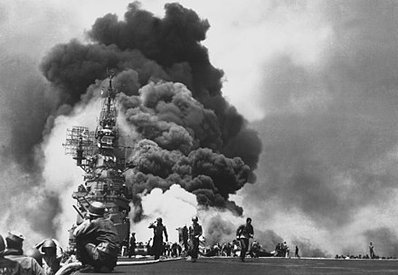 American aircraft carrier USS Bunker Hill burns after being hit by two kamikaze planes within 30 seconds. USS Bunker Hill hit by two Kamikazes.jpg
