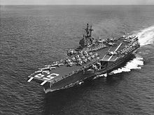 USS Forrestal (CVA-59) underway at sea in 1957