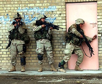 Second Battle of Fallujah - U.S. Army soldiers from TF 2–7 CAV, prepare to enter a building during fighting in Fallujah.