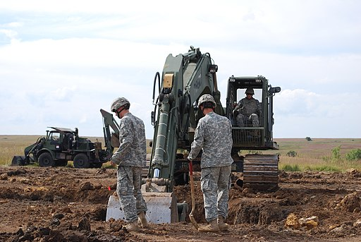 US Army 51403 Fort Riley, Fort Leonard Wood Soldiers work together on trench project