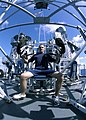 US Navy 041207-N-5362F-214 Damage Controlman 3rd Class Jiri Haken of Huntington Beach, Calif., works-out on a seated bench press at an outside gym on the deck of the guided missile cruiser USS Shiloh (CG 67).jpg