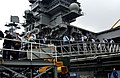 US Navy 050328-N-5821P-030 Sailors depart the brows aboard the conventionally powered aircraft carrier USS Kitty Hawk (CV 63) after returning to her forward deployed operating base, Commander Fleet Activities Yokosuka, Japan.jpg
