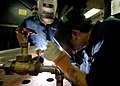 US Navy 050902-N-4308O-001 Hull Technician Fireman Steven Irwin, left, and Hull Technician Fireman Chance Brooks weld stanchions to a potable fresh water manifold in the Machine Shop aboard the Nimitz-class aircraft carrier USS.jpg