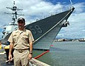 US Navy 050928-N-9643K-001 USS Russell (DDG 59) Commanding Officer Cmdr. James W. Kilby stands in front of his ship, after returning from a two-month deployment participating in the Alaska Shield-Northern Edge 2005.jpg