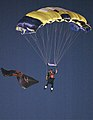 US Navy 051001-N-1722M-581 A Member of the U.S. Navy Parachute Team, the Leap Frogs, sports a San Diego Aztecs uniform and flag as he descends into Qualcomm Stadium.jpg