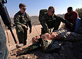 US Navy 051130-N-6901L-026 U.S. Navy Hospital Corpsman 1st Class Seth Von Borstel, assigned to Helicopter Sea Combat Squadron Two One (HSC-21), delivers first aid to a training mannequin.jpg