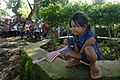 US Navy 060613-N-6501M-031 A young Filipino girl watches the U.S. Navy Showband perform during a special concert presented at the Batu Batu Naval Base on a neighboring island near Tawi Tawi.jpg