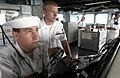 US Navy 060627-N-9851B-006 Seaman Matthew Douglas controls the ship's speed from the lee helm as Gunner's Mate 3rd Class Aaron Prenger steers from the helm as rescue and salvage ship USS Salvor (ARS 52) departs Thailand.jpg