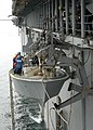US Navy 060906-N-1598C-001 A Landing Craft Personnel Large (LCPL) is lowered over the side of the amphibious assault ship USS Saipan (LHA 2).jpg