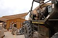 US Navy 061216-N-5758H-262 1st Lt. John Reeves instructs fork lift driver Sgt. James Sanchez, both assigned to Marine Aviation Logistics Squadron (MALS) 16, Supply Detachment A, to bring the forks on the 10k fork lift down whil.jpg