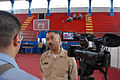 US Navy 070706-N-8704K-201 Mass Communication Specialist 2nd Class Brandon Shelander interviews Lt. Johnny Ramos, site leader for the Paul Brown Arena. Both Shelander and Ramos are attached to Military Sealift Command hospital.jpg